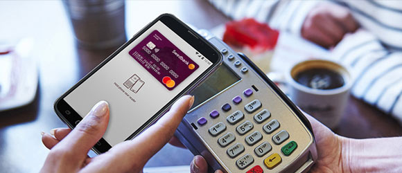 Use a business credit cards to make contactless payments with a mobile device